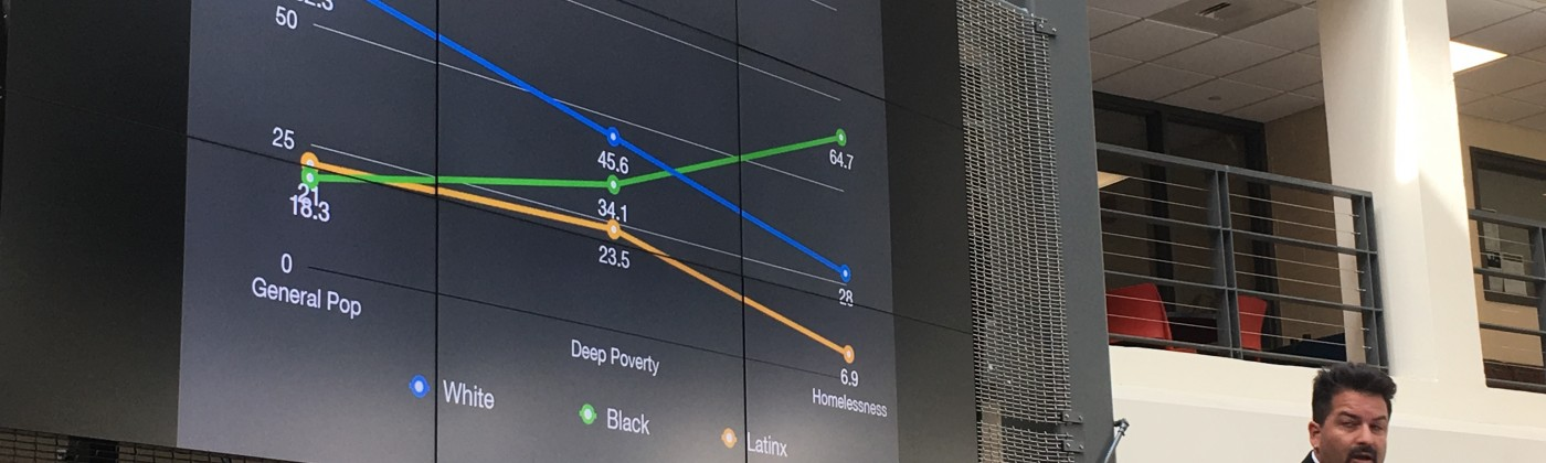 Jeff Olivet, senior advisor to the Center for Social Innovation shows data on the impact of homelessness on African American, Latino and white communities. Photo by Tamela Luce.