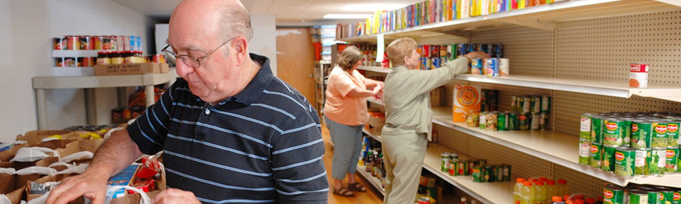 Three people shopping in a food pantry