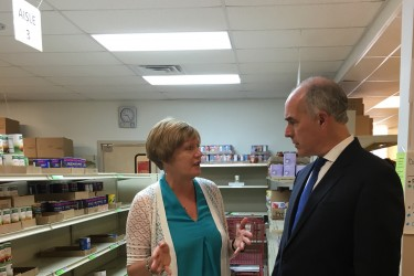 Pottstown Cluster of Religious Communities Executive Director Barbara Wilhelmy gives Sen. Bob Casey a tour of their food pantry. All photos by Tamela Luce.
