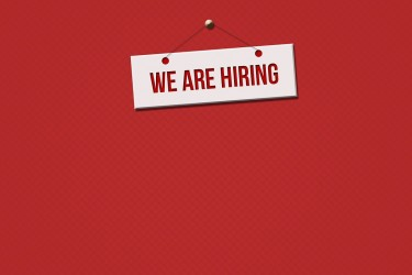 "Sign against a red background that reads, ""We are hiring"""