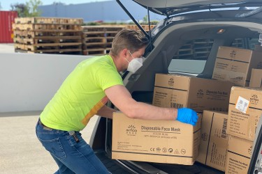 man loading boxes into car