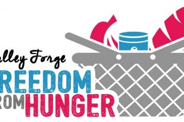 "Graphic logo of a picnic basket full of food with the words, ""Valley Forge Freedom from Hunger"" on the left."